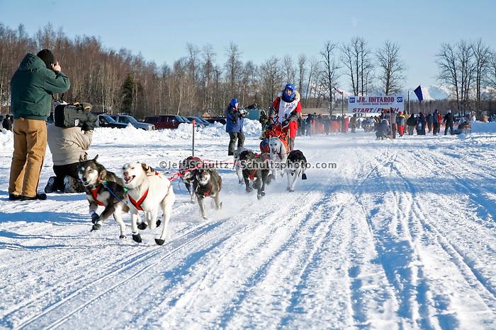 Saturday, February 24th, Knik, Alaska.  Jr. Iditarod musher Jessica Klejka leaves start line on Knik Lake