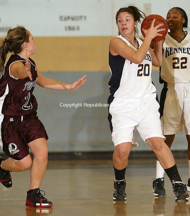 WATERBURY, CT, 01/09/08- 010909BZ07-  Kennedy's Kasiana Goodman (20) under pressure from Torrington's Kaylee Cerruto (20) Friday night. <br />  Jamison C. Bazinet Republican-American