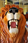 Carousel roaring lion at historic Nunley's Carousel Centennial Celebration on Saturday, June 9, 2012, at Museum Row, Garden City, Long Island, New York, USA. 100th Anniversary festivities included old time game of croquet; a visit from ex-President Theodore Roosevelt - portrayed by actor James Foote - who ran again for President in 1912 (unsuccessfully, as Bull Moose Party candidate), the year Nunley's Carousel debuted; and Carousel rides.