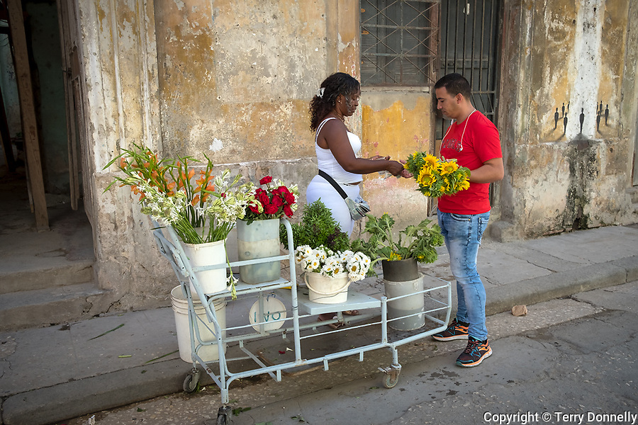 Havana, Cuba:<br /> Street scene with flower vendor