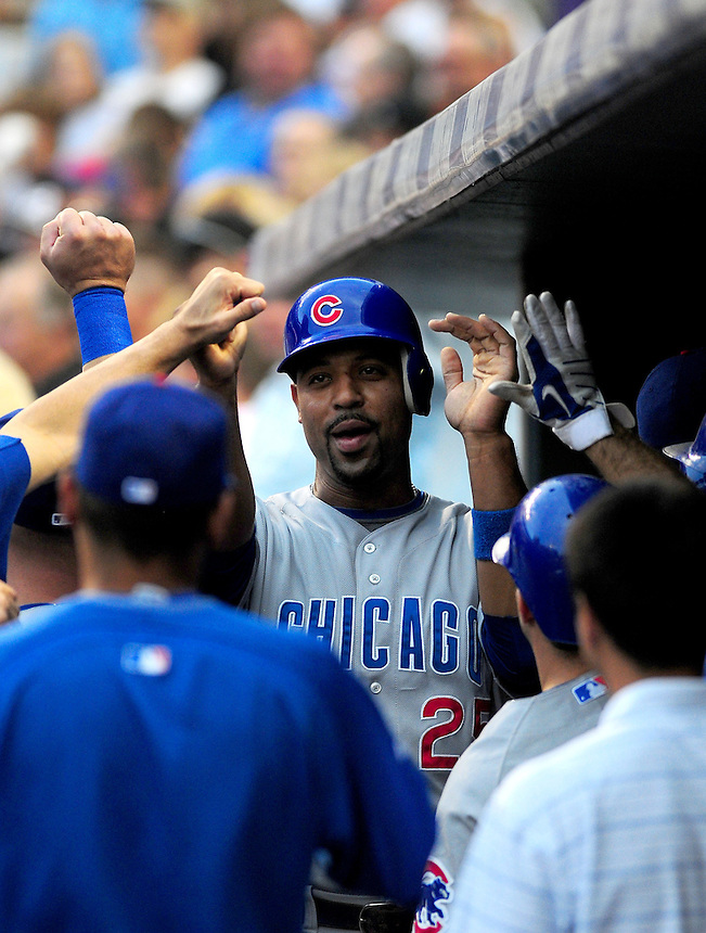 August 8, 2009: Cubs 1st baseman Derrek Lee celebrates scoring a run in the dugout with teammates during a regular season game between the Chicago Cubs and the Colorado Rockies at Coors Field in Denver, Colorado. The Cubs beat the Rockies 6-5. *****For editorial use only*****