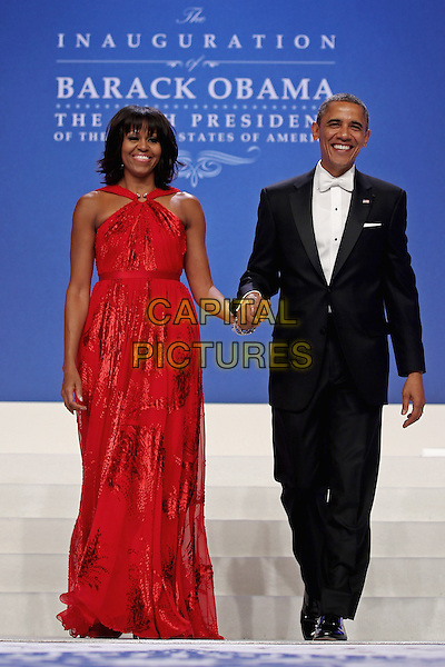 Michelle Obama & Barack Obama.2013 Inauguration Ball, Washinton D.C., USA..January 21st, 2013.full length black suit tuxedo red dress holding hands married husband wife        .CAP/ADM/CNP/CS.©Chip Somodevilla/CNP/AdMedia/Capital Pictures
