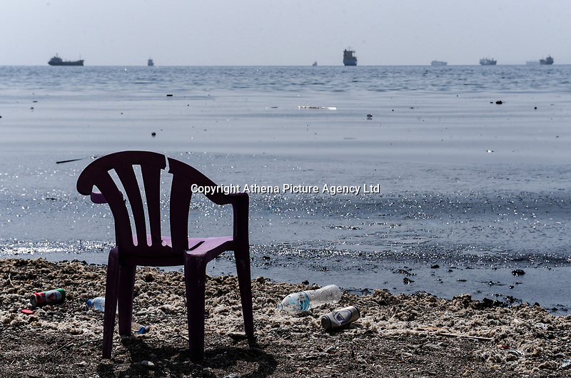 """Pictured: The oil spill that has reached the coast of Salamina, Greece<br /> Re: An oil spill off Salamina island's eastern coast is spreading and has become """"an environmental disaster"""" according to local authorities in Greece.<br /> The spill was caused by the sinking of the Aghia Zoni II tanker, carrying 2,200 metric tons of fuel oil and 370 metric tons of marine gas oil on Saturday, southwest of the islet of Atalanti near Psytalleia. According to reports, the coastline stretching from Kinosoura to the Selinia community has """"turned black"""" and authorities fear a new leak from the sunken ship.<br /> According to the island's mayor, Isidora Papathanasiou, the weather """"turned on Sunday afternoon and brought the oil spill to Salamina."""""""