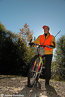 Woman hunter on a bicycle