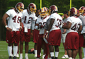 Ashburn, VA - May 4, 2003 -- Former New York Jets Kick Returner and Running Back Chad Morton (20) huddles with his new teammates during a pre-season mini-camp at Redskin Park in Ashburn, Virginia on May 4, 2003. Left to right: Tight End Kevin Ware (48), Quarterback Gibran Hamdan (12), Morton (20), Full Back Mike Ajayi (37), and Full Back Rock Cartwright (40)..Credit: Ron Sachs / CNP