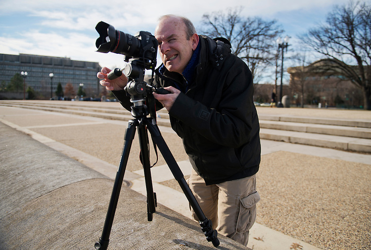 UNITED STATES - JANUARY 13: Roy Harris of Capitol Hill takes a series of photos of the Capitol across the reflecting pool for a time lapse photography project. (Photo By Tom Williams/CQ Roll Call)