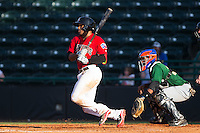 Josh Morgan (3) of the Hickory Crawdads follows through on his swing against the Savannah Sand Gnats at L.P. Frans Stadium on June 14, 2015 in Hickory, North Carolina.  The Crawdads defeated the Sand Gnats 8-1.  (Brian Westerholt/Four Seam Images)
