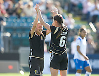 Tiffeny Millbrett, left, and Brandi Chastain celebrate. FC Gold Pride defeated the Boston Breakers 2-1 at Buck Shaw Stadium in Santa Clara, California on April 5th, 2009.