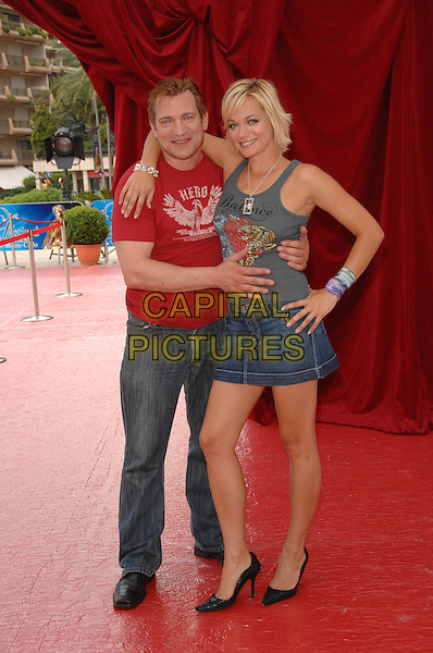 "DIMITRI DIATCHENKO & CRYSTAL ALLEN.Attends a photocall promoting the television series ""Indiana Jones"" and actress Crystal Allen promotes the television series ""Anaconda 3 & 4"" on the fifth day of the 2008 Monte Carlo Television Festival held at Grimaldi Forum, Monte Carlo, Principality of Monaco, June 12th 2008..full length red t-shirt jeans denim skirt hand on hip black shoes.CAP/TTL .©TTL/Capital Pictures"