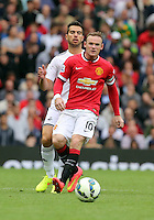 Pictured L-R: Jordi Amat of Swansea against Wayne Rooney of Manchester Unitedl. Saturday 16 August 2014<br />