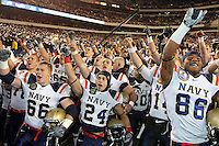 PHILADELPHIA - DECEMBER 11: The Navy Midshipmen celebrate their victory after a game against the Army Black Knights on December 11, 2010 at Lincoln Financial Field in Philadelphia, Pennsylvania. The Midshipmen won 31-17. (Photo by Hunter Martin/Getty Images) *** Local Caption ***