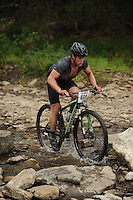 NWA Democrat-Gazette/ANDY SHUPE<br /> Brett Cochran of Harrison rides across Lee Creek Saturday, Sept. 19, 2015, during the Northwest Arkansas Mountain Bike Championships at Devil's Den State park.