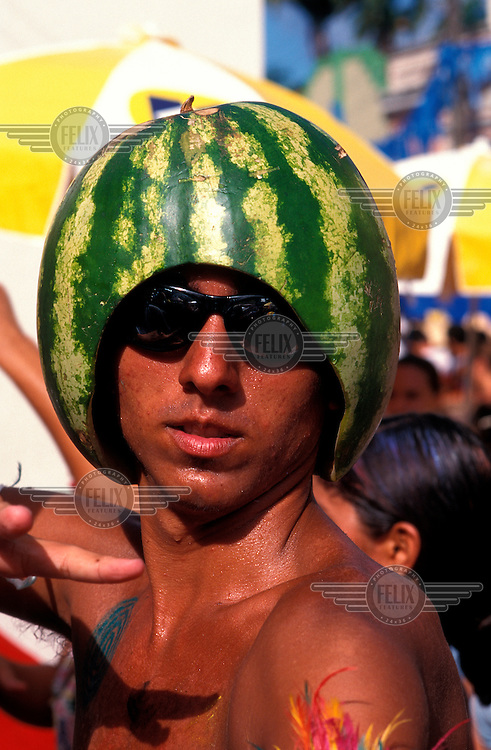 A man with a watermelon on his head at the Recife and Olinda carnival, which is billed as the biggest street party in the world.