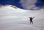 Anna Siebelink shouts for joy after skiing down to the site of the group's camp for the evening at the head of Deadman's Canyon during their 6 day crossing of the Sierra High Route.