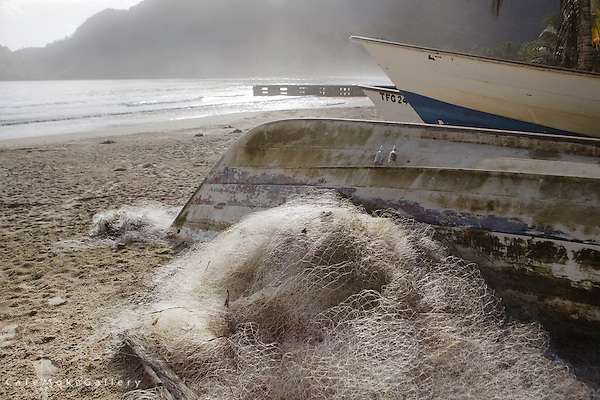 Early morning scene of fishing nets and pirogues on Maracas beach