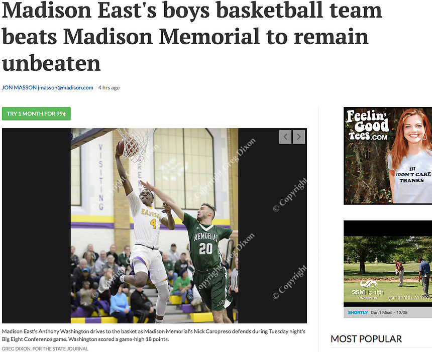 East's Anthony Washington hits a game high 18 points, here under pressure by Memorial's Nick Caropreso, as Madison Memorial takes on Madison East in Wisconsin Big Eight Conference boys high school basketball on Tuesday, 12/4/18, at East High School | Wisconsin State Journal article front page Sports 12/5/18 and online at https://madison.com/wsj/sports/high-school/basketball/boys/madison-east-s-boys-basketball-team-beats-madison-memorial-to/article_d5db2856-dbd9-52c2-9e57-ef52aa25221c.html