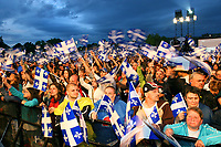 Quebec City, June 23, 2007 ? Spectators  wave their flags  during the St-Jean-Baptiste show on the Plains of Abraham in Quebec City June 23, 2007. Thousand of Quebecer gathered on the Plains to celebrates their National day.<br /> <br /> PHOTO :  Francis Vachon - Agence Quebec Presse