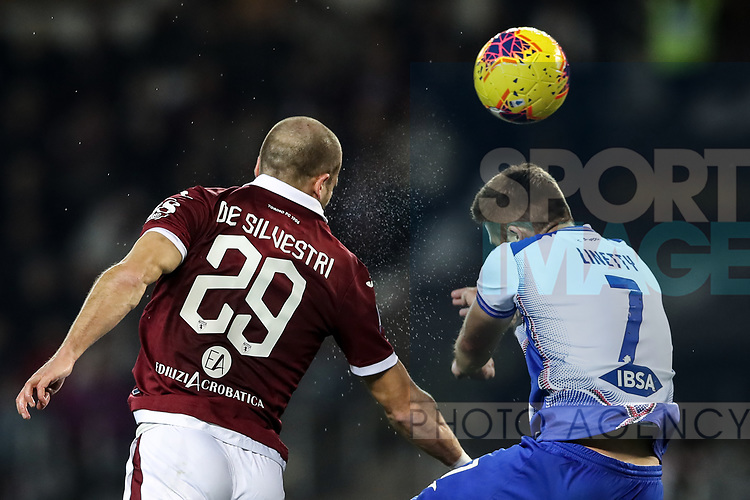 Lorenzo De Silvestri of Torino FC wins this aerial duel with Karol Linetty of Sampdoria during the Serie A match at Stadio Grande Torino, Turin. Picture date: 8th February 2020. Picture credit should read: Jonathan Moscrop/Sportimage