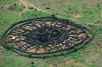 UGANDA, Karamoja, Kaabong, karamojong pastoral tribe, aerial view of homestead with huts and cattle ground, the wooden fencing is a protection from hostile tribes and cattle raiders  / Karamojong Ethnie, Luftaufnahme eines Karamojong Dorfes mit Schutzzaeunen aus Holzstoeckern vor feindlichen Angriffen