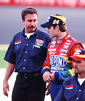 Jeff Gordon walks down pitroad with his crew chief, Robbi Loomis (left) at Richmond International Raceway on Friday, 9/8/00.  Although Gordon won the next day's NASCAR race, Loomis was fined $25,000 by NASCAR when an illegal part was found on the car in a post-race inspection.(Photo by Brian Cleary)