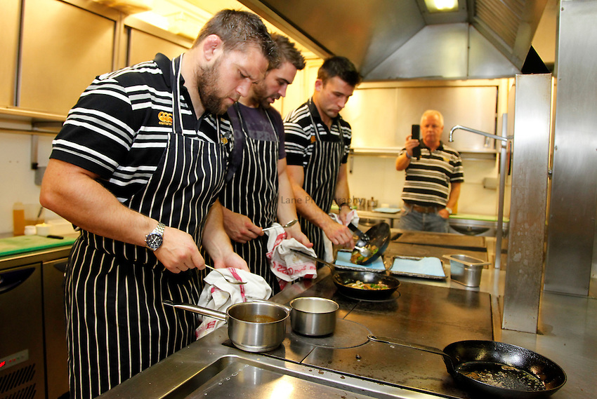 Photo: Richard Lane/Richard Lane Photography. London Wasps players coooking competition under the supervision of head Chef, Phil Thompson at Auberge du Lac, Brocket Hall, Hertfordshire. 03/10/2011.   Ben Broster, Nick Robinson and Chris Bell cook the vegetables.