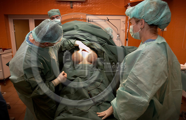 "SZCZECIN - POLAND  09. NOVEMBER 2006 -- A breast enlargement (380 gram Breast Implantant) on a german woman in the private plastic surgery clinic ArtPlastica  in Szczecin by dr M. Pastucha, plastic surgeon -- PHOTO: CHRISTIAN T. JOERGENSEN / EUP & IMAGES..This image is delivered according to terms set out in ""Terms - Prices & Terms"". (Please see www.eup-images.com for more details)"