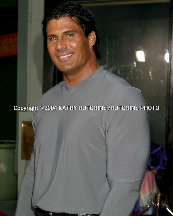 "©2004 KATHY HUTCHINS /HUTCHINS PHOTO.""EXORCIST THE BEGINNING"" PREMIERE.GRAUMAN'S CHINESE THEATER.LOS ANGELES, CA.AUGUST 18, 2004..JOSE CONSECO."