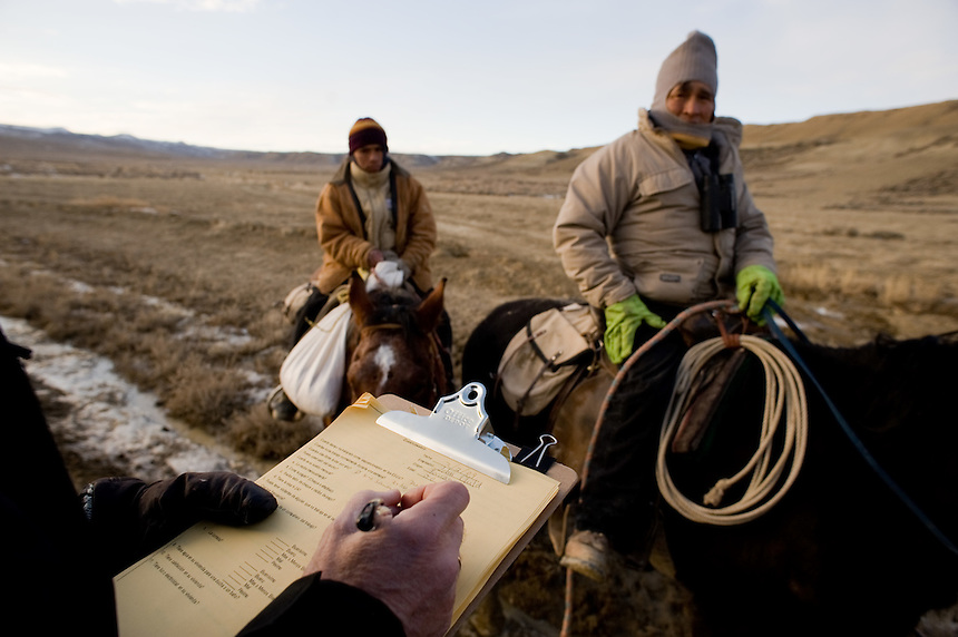 Peruvian sheep herders move their flock along a road through Bureau of Land Management land near Rock Springs, Wyo., Saturday, Feb. 7, 2009. Sheep herders working in southern Wyoming along the Colorado border complain of low pay, poor accomodations and lack of health care after they arrive on H2A visas to work for local ranchers. (Kevin Moloney for the New York Times)