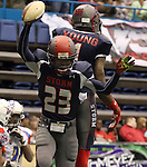 SIOUX FALLS, SD - JUNE 7 Michael Johnson #23 and Martevious Young #1 from the Sioux Falls Storm celebrate a touchdown against the Texas Revolution in the first quarter of their game Saturday night at the Sioux Falls Arena. (Photo by Dave Eggen/Inertia)