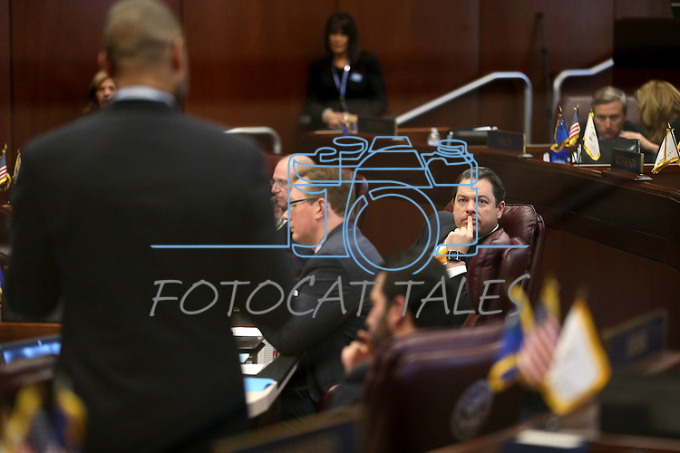 Nevada Senate Majority Leader Michael Roberson, R-Las Vegas, center, listens as Senate Minority Leader Aaron Ford, D-Las Vegas, speaks on the Senate floor at the Legislative Building, in Carson City, Nev., on Friday, Feb. 20, 2015. <br /> Photo by Cathleen Allison