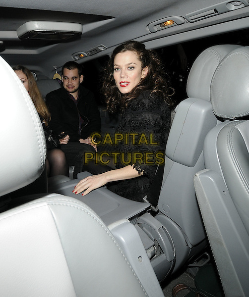 ANNA FRIEL.leaving performance of 'Breakfast at Tiffany's' at Theatre royal, Haymarket, London, England, UK,.30th December 2009.half length black jacket sitting in car shot hand arm red lipstick make-up .CAP/CAN.©Can Nguyen/Capital Pictures.