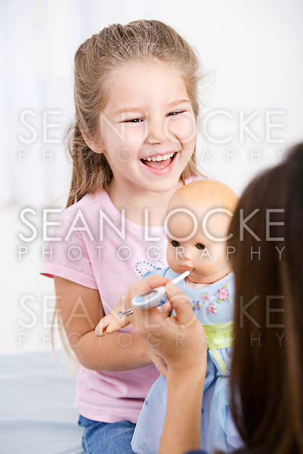 Image series of an Asian-American nurse.  Some include Caucasian adult and child patients.