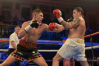 Chris Billam-Smith (red/black shorts) defeats Robin Dupre during a Boxing Show at York Hall on 13th October 2018