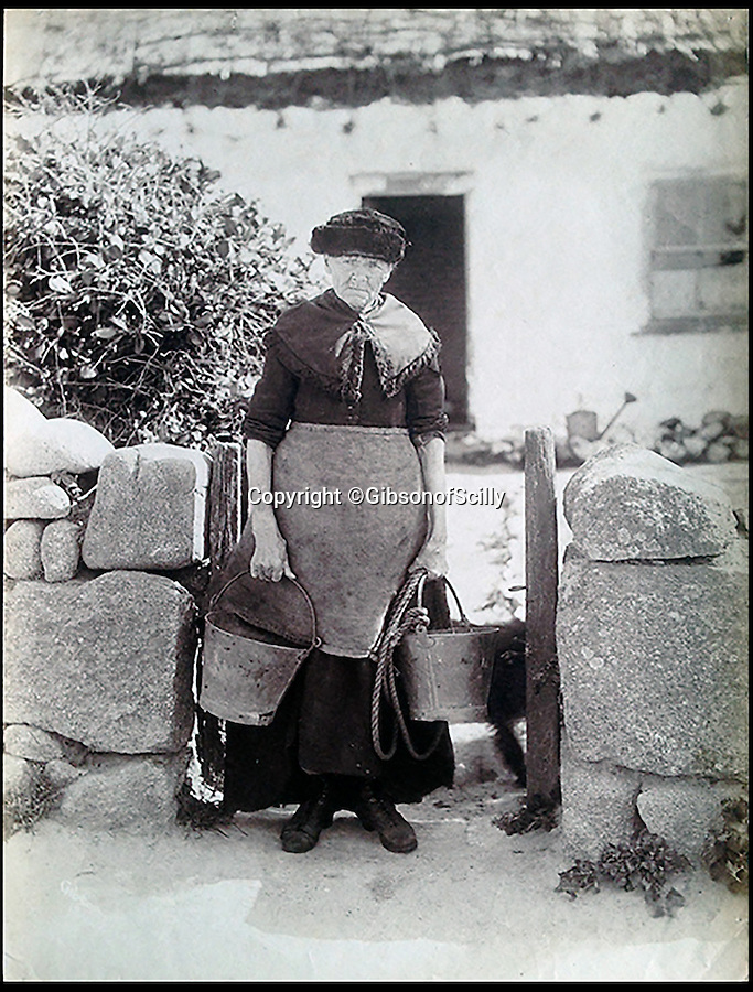 BNPS.co.uk (01202 558833)<br /> Pic: GibsonOfScilly/BNPS<br /> <br /> Fetching water.<br /> <br /> An archive of eye-opening photographs documenting the grim reality of Poldark's Cornwall has emerged for sale for £25,000.<br /> <br /> More than 1,500 black and white images show the gritty lives lived by poverty-stricken families in late 19th and early 20th century Cornwall - around the same time that Winston Graham's famous Poldark novels were set.<br /> <br /> The collection reveals the lowly beginnings of towns like Rock, Fowey, Newquay and St Ives long before they became picture-postcard tourist hotspots.<br /> <br /> Images show young filth-covered children playing barefoot in squalid streets, impoverished families standing around outside the local tax office, and weather-beaten fishwives tending to the day's catch.<br /> <br /> The Cornish archive, comprising 1,200 original photographic prints and 300 glass negative plates, is tipped to fetch £25,000 when it goes under the hammer as one lot at Penzance Auction House.
