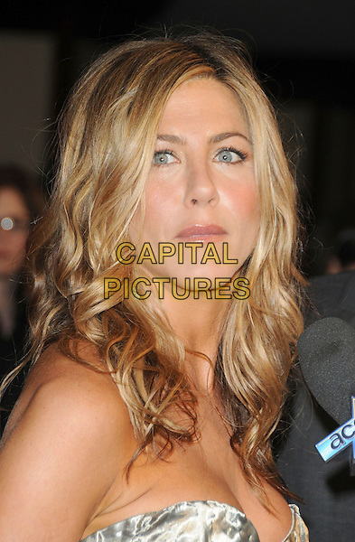 JENNIFER ANISTON .at The Women in Film 2009 Crystal .and Lucy Awards held at The Hyatt Regency Century Plaza in Century City, California, USA, June 12th 2009                                                                     .portrait headshot gold silver metallic shiny bustier cleavage strapless hair down wavy microphone interview .CAP/DVS.©DVS/RockinExposures/Capital Pictures