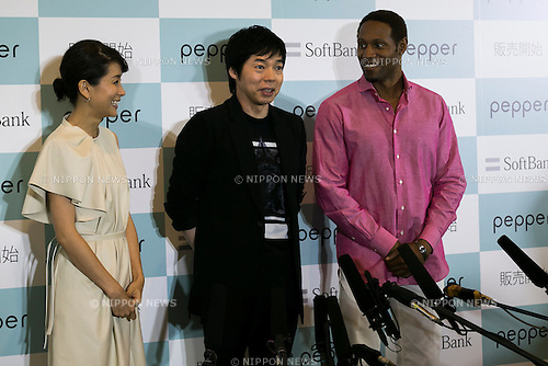 (L to R) Announcer Kyoko Uchida, actor Koji Imada and actor Dante Carver answer journalist questions during press conference to announce that the SoftBank's robot ''Pepper'' can feel like a human on June 18, 2015, Tokyo, Japan. Masayoshi Son chairman & CEO of Japanese internet and telecommunications giant SoftBank Corp., announced that its robot Pepper can feel and understand people's emotions and also express itself. Son also said that the first 1000 robots will be on sale to the public for 198,000 JPY (1,604 USD) from Saturday June 20th, and could be available to companies to replace positions such as reception and convenience store staff from the beginning of July. To develop Pepper's skills SoftBank announced an alliance with foreign technology companies FOXCONN and Alibaba Group. (Photo by Rodrigo Reyes Marin/AFLO)