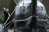 United States President Donald J. Trump waves to journalists as he boards Marine One on departure from Walter Reed National Military Medical Center following his annual physical examination January 12, 2018 in Bethesda, Maryland. Trump will next travel to Florida to spend the Dr. Martin Luther King Jr. Day holiday weekend at his Mar-a-Lago resort. <br /> Credit: Chip Somodevilla / Pool via CNP