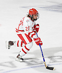 MADISON, WI - SEPTEMBER 29: Phoebe Monteleone #23 of the Wisconsin Badgers women's hockey team handles the puck against the Quinnipiac Bobcats at the Kohl Center on September 29, 2006 in Madison, Wisconsin. The Badgers beat the Bobcats 3-0. (Photo by David Stluka)