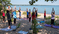 "Blue skies and the blue water of Lake Huron made an ideal location for Karen Keresturi's yoga class held on the shores of Canatara Park. Karen, owner of Spiral Yoga says ""I usually teach from the Lochiel Kiwanis Centre and yet in the summer...I move outdoors to Canatara as I cannot resist the beauty of the lake and the breeze  and the birds....it is the best accompaniment to a yoga practice."