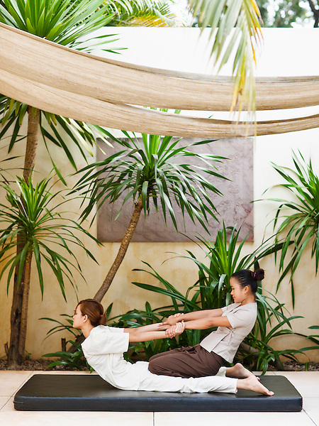 Woman receiving Energy Massage outdoors at Visaya Spa, FCC Angkor, Siem Reap, Cambodia. The Energy Massage is a dry spa treatment incorporating Thai massage techniques.