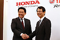 Honda Motor Operating Officer and Director Shinji Aoyama, left, shakes hands with Yamaha Motor Managing Executive Officer and Director Katsuaki Watanabe during a joint press conference in Tokyo, Japan on October 5, 2016. Japanese auto majors Honda and Yamaha announced they have started talks toward a business tie-up in the development and production of small scooters. (Photo by Yosuke Tanaka/AFLO)