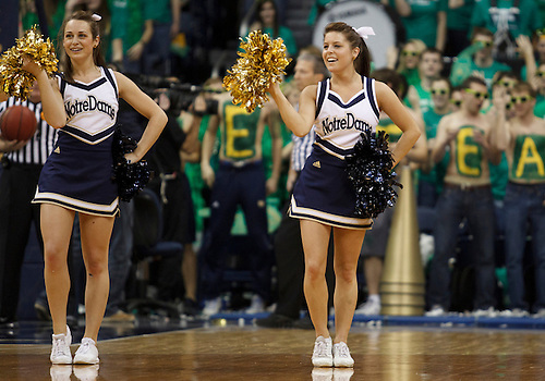 Notre Dame cheerleaders Maddie Genereux (right) and Allie Rzepczynski (left) perform during NCAA Men's basketball game between Marquette and Notre Dame.  The Notre Dame Fighting Irish defeated the Marquette Golden Eagles 76-59 in game at Purcell Pavilion at the Joyce Center in South Bend, Indiana.