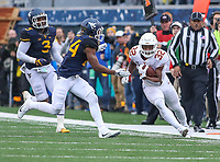 Morgantown, WV - November 18, 2017: Texas Longhorns running back Daniel Young (32) runs the ball during game between Texas and WVU at  Mountaineer Field at Milan Puskar Stadium in Morgantown, WV.  (Photo by Elliott Brown/Media Images International)