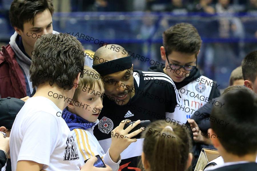 Kosarka ABA League season 2014-2015<br /> Partizan v Zadar<br /> Josh Akognon with the fans navijacima supporters<br /> Beograd, 15.03.2015.<br /> foto: Srdjan Stevanovic/Starsportphoto&copy;