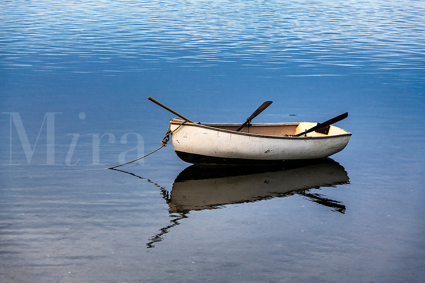 Rowboat anchored in shallow water, Chatham, Cape Cod, Massachusetts, USA.