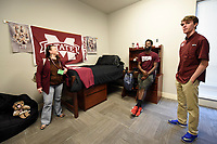 Samuel Shelby and Alex Heath show the demo room to a parent during the residence hall open house at Oak Residence Hall.<br /> <br /> (photo by Logan Kirkland / &copy; Mississippi State University)