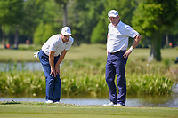 Ross Fisher (ENG) looks over his lie on 17 with Jamie Donaldson (WAL) during Round 2 of the Zurich Classic of New Orl, TPC Louisiana, Avondale, Louisiana, USA. 4/27/2018.<br /> Picture: Golffile | Ken Murray<br /> <br /> <br /> All photo usage must carry mandatory copyright credit (&copy; Golffile | Ken Murray)