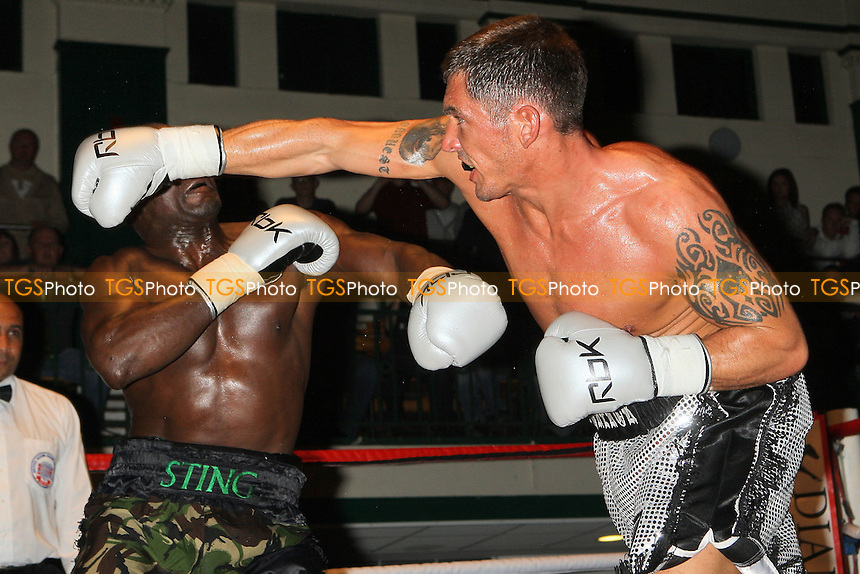 Tony Conquest (silver shorts) defeats Hastings Rasani in a Cruiserweight boxing contest at York Hall, Bethnal Green, promoted by Steve Goodwin - 11/09/10 - MANDATORY CREDIT: Gavin Ellis/TGSPHOTO - SELF-BILLING APPLIES WHERE APPROPRIATE. NO UNPAID USE. TEL: 0845 094 6026