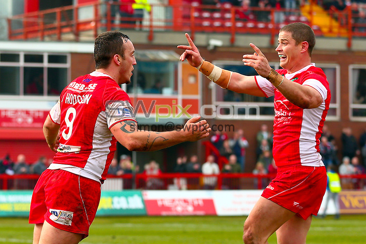 Picture by Alex Whitehead/SWpix.com - 30/03/2014 - Rugby League - First Utility Super League - Hull Kingston Rovers v Wakefield Trinity Wildcats - KC Lightstream Stadium, Hull, England - Hull KR's Josh Hodgson (L) celebrates his try with Travis Burns (R).