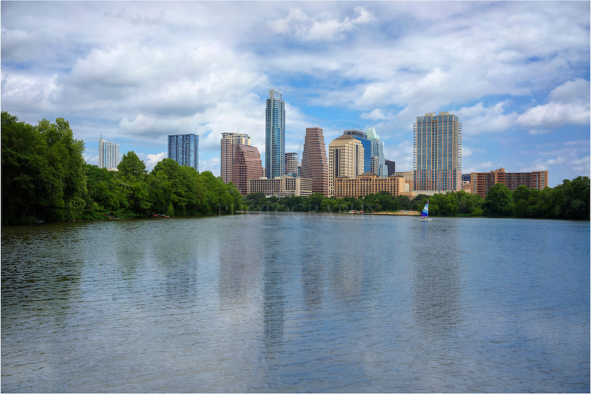 From the newly constructed boardwalk just east of Congress Avenue, joggers, bikers, and pedestrians can enjoy an afternoon stroll with a great view of the Austin skyline. Prominently featured in this image is the Austonian, Austin's tallest building.